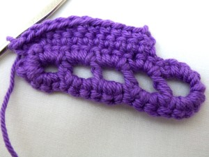 CH 2, turn. Continuing to work in the back of the stitches (the ones now closest to you since you've turned the piece over) SC into each stitch until reaching the corner.