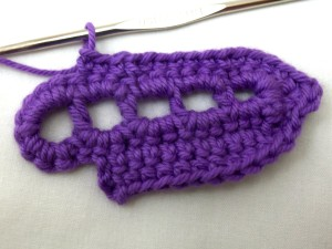 Continue SC (into back of stitch) to just above the last DC. CH 2 and turn.