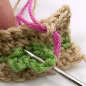 First rose stitch through leaf
