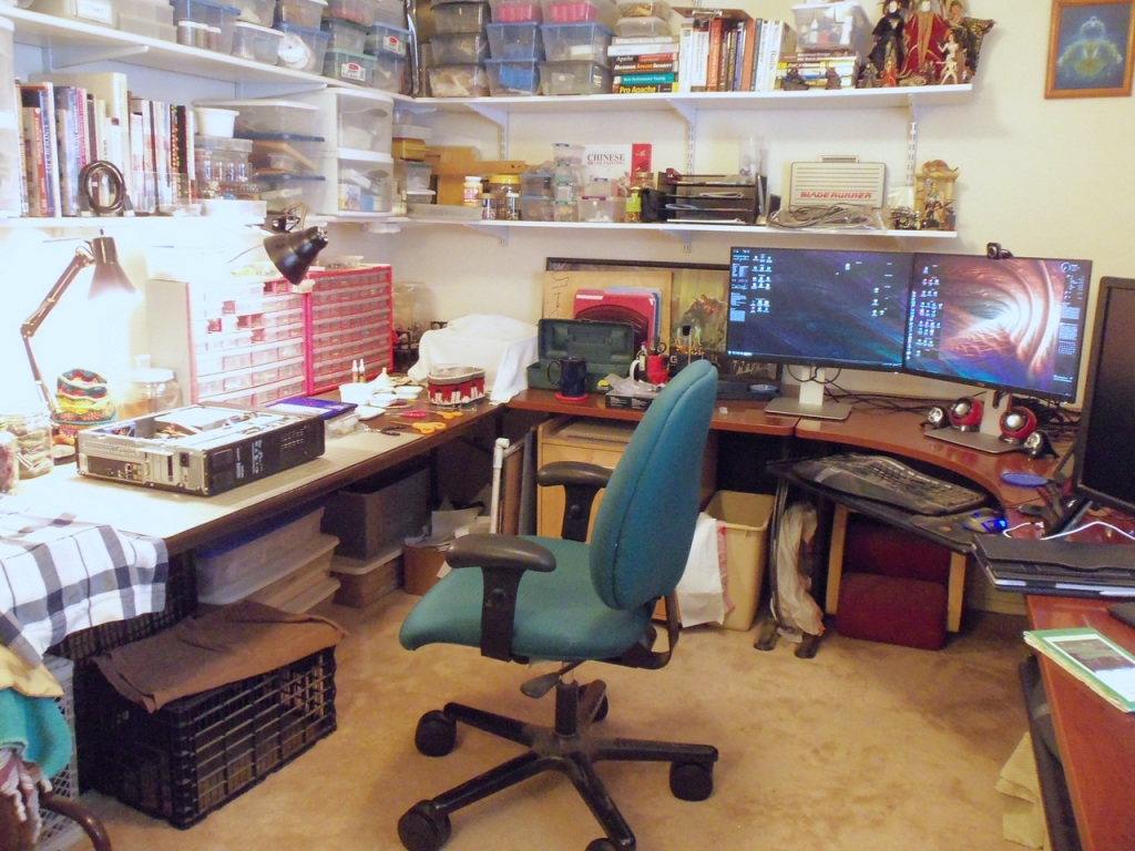 Battlestation shot. This is our studio/workshop. Everything from computer repair to jewelry design to electronics tinkering to watercolor painting goes on in here. There are two dual-monitor workspaces set up, one with another Inspiron for doing basic computing (blogging, Etsy, surfing, taxes, etc.), the other with a laptop dock for telework.